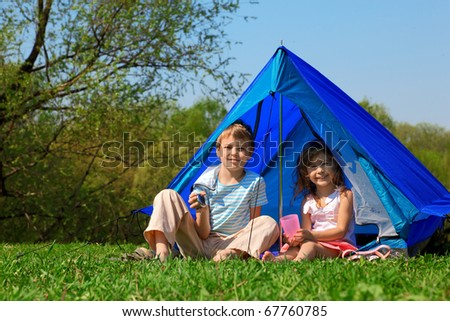 children in tent sunny day