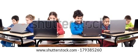Children in the classroom with laptop computers