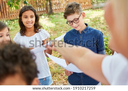 Children in the summer camp at the choir rehearsal under guidance for the talent show performance Stock photo ©