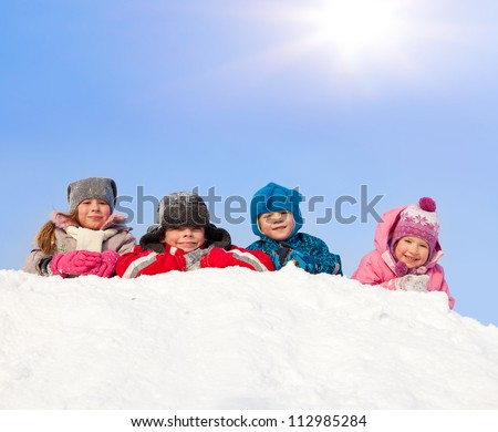 Children in winter. Happy kids on snow
