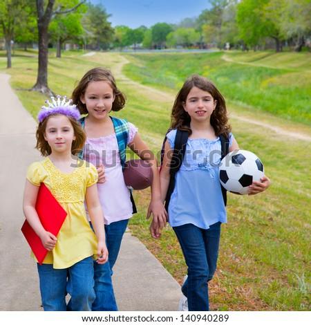 Children kid girls walking to school with sport balls folders and backpacks in outdoor park