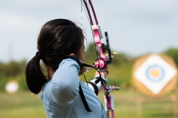 Children  learn compound bows in archery lessons.