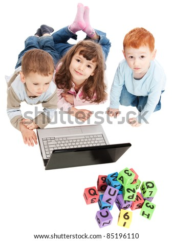 Children learning with computer and alphabet blocks. Isolated on white