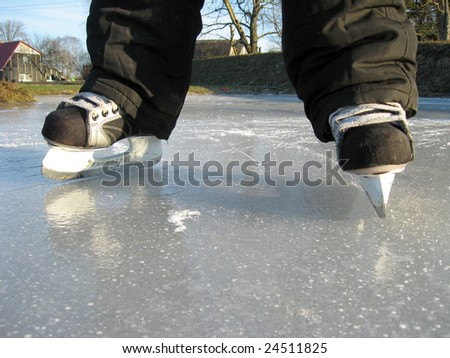 Children legs with simple skates close up
