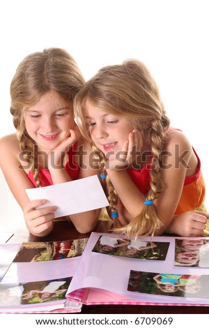 children looking at photos together vertical