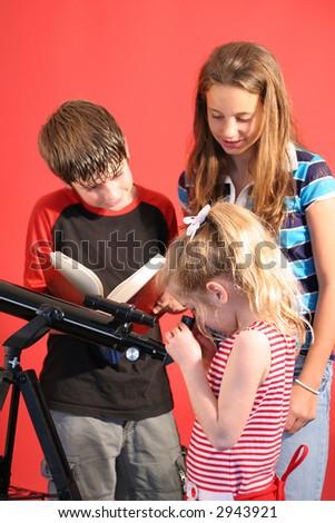 children looking thru telescope vertical