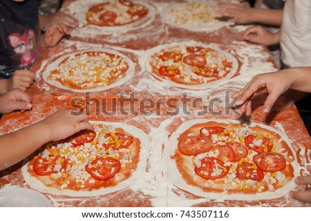 ee6435fbbc19 Children make pizza. Master class for children on cooking Italian pizza.  Young children learn