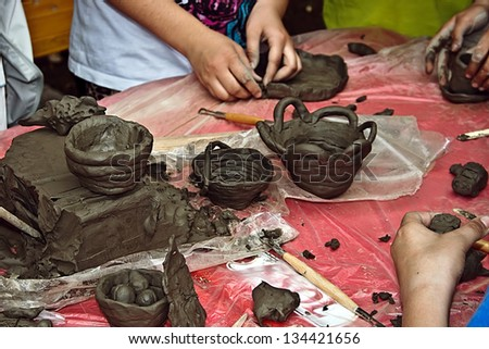 Children molding clay at a workshop held at the International Children\'s Day. Timisoara, Romania.
