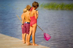 Children on dock by the lake