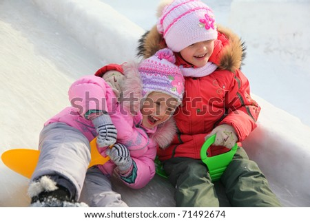 children on ice hill at winter