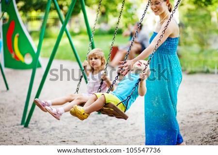 children on swing soft focus (focus on boy's eyes)