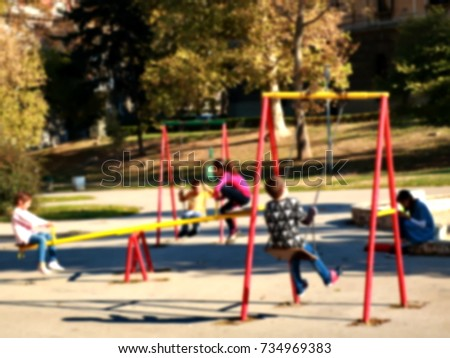 Children on the swing, blur background #734969383