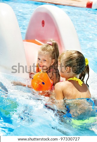 Children on water slide at aquapark. Summer holiday. - stock photo