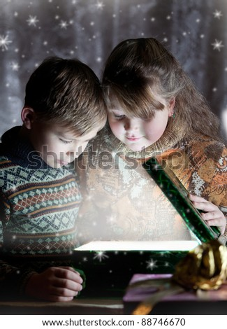 Children opening christmas magic present