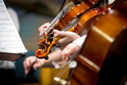 Children orchestra playing violin