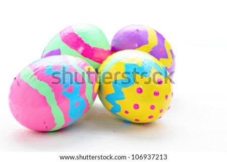 children paint colorful easter egg