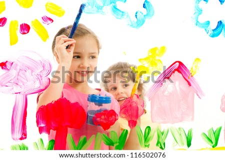 Children painting artwork on glass. Isolated on white.