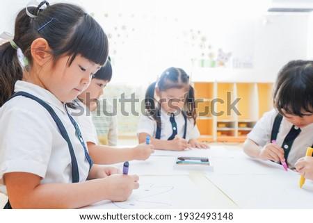 Children painting at nursery school Stock photo ©