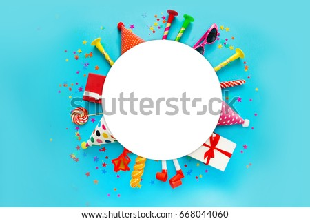 children party background. birthday background. Colorful party frame with  cap and whistle  on blue background