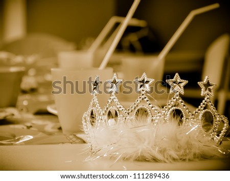 Children party sepia background with young princess crown