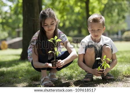 Children planting a new tree Concept new life environmental conservation