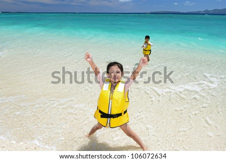 Children play at the beach