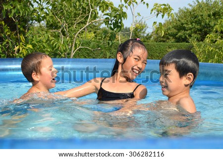 Children play in the garden pool and have fun