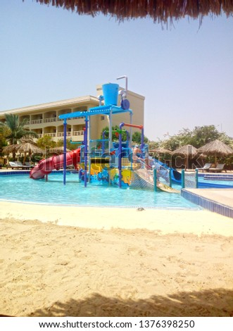 children play in the water park on site in Hurghada