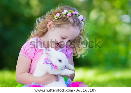 children play with real rabbit. ...