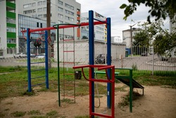Children playground in the courtyard of a multi-storey building.