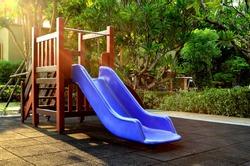 Children playground under sunlight - blue slider