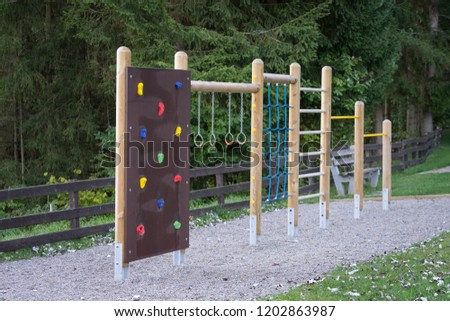 Children playground with many kind of  plaything around by wonderful nature and environment. Object selected focus. - Shutterstock ID 1202863987