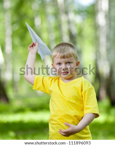 Children playing and flying a paper airplane