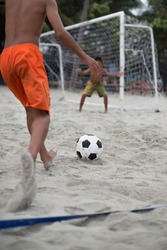 children playing beach soccer