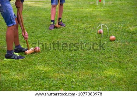 Children playing croquet in summer