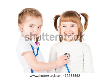 Children playing doctor, isolated on white
