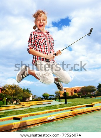 Children playing golf in park. Outdoor.