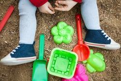children playing in a sandbox toy shovel bucket