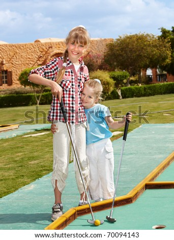 Children playing in golf. Outdoor. - stock photo