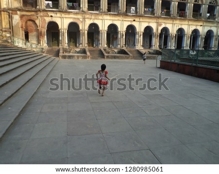 children  playing in histroical place