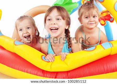 Children playing in swimming pool studio shot #100285112