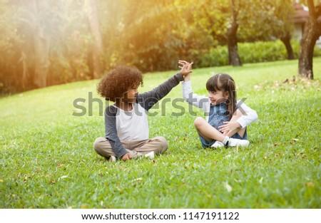 Children playing in the garden in summer day #1147191122