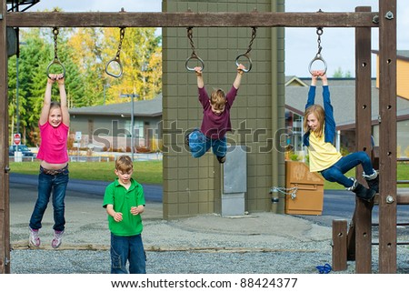 Children playing on a school playground during recess.
