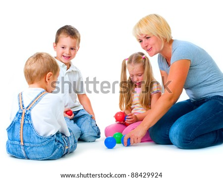 Children playing on the floor with Teacher.Happy kids.Education.