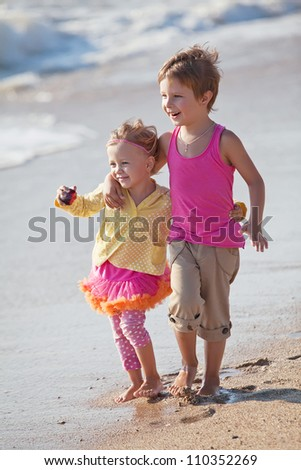 Children playing outdoors at the sea