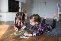 Children playing puzzles at home