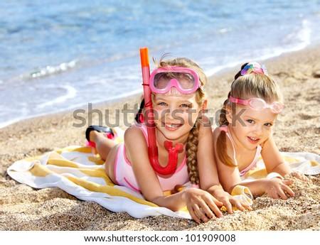 Children  playing summer outdoor on  beach.