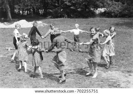 Children playing together in a circle