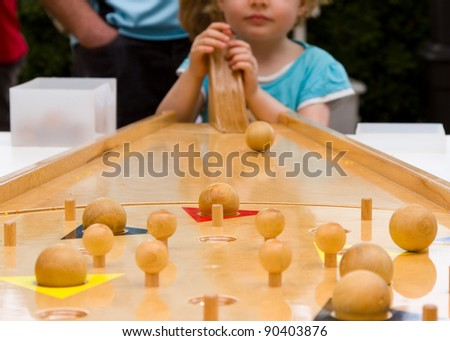 Children playing with an old wood game.