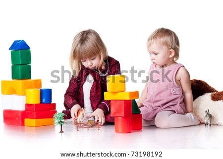 Children playing with blocks isolated on white